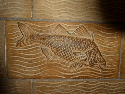 A fish, one of the many decorative features incorporated into Alfred Waterhouse's Natural History Museum, London.