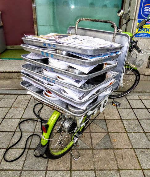 I chose this bicycle from Seoul, South Korea, loaded up with lunch time meals, cooked in tiny kitchens, and delivered to workers on site.