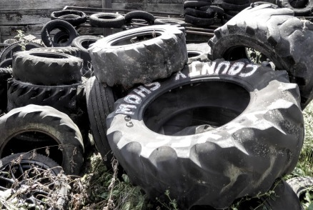 Grotty old tyres in a rather grotty farmyard. But years of use has made their surfaces smooth, as moving close in demonstrates.